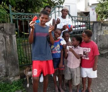 Kids in St Vincent with tracts provided by tellthetriad